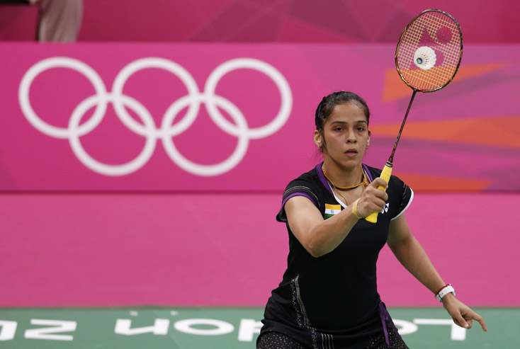 India's Saina Nehwal plays against Belgium's Lianne Tan during their women's singles group play stage Group E badminton match during the London 2012 Olympic Games at the Wembley Arena