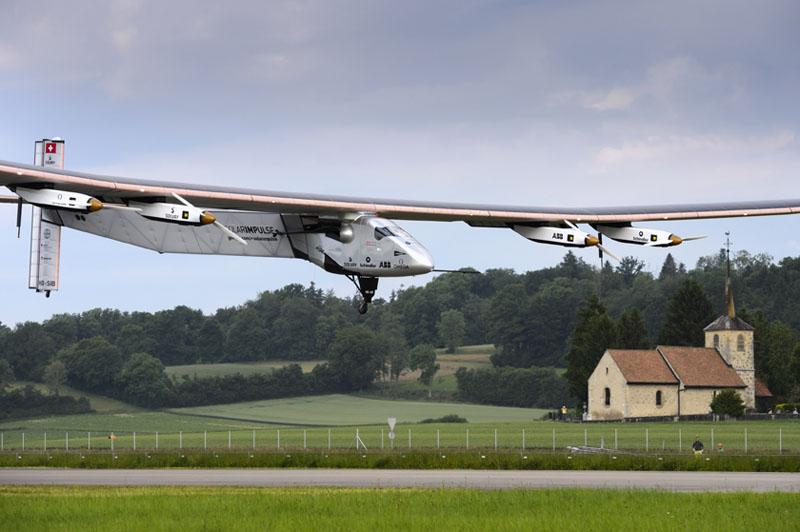 The solar-powered Solar Impulse 2 experimental aircraft flown by German test pilot Markus Scherdel, lands during its maiden flight in Payerne