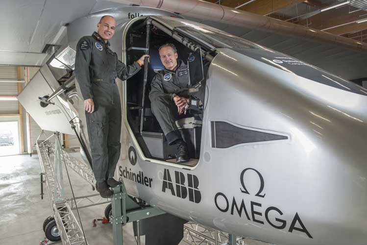 André Borschberg and Bertrand Piccard beside the cockpit of Solar Impulse 2