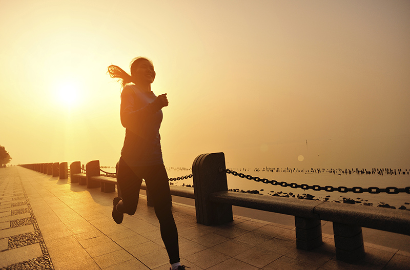 healthy lifestyle asian woman running at seaside